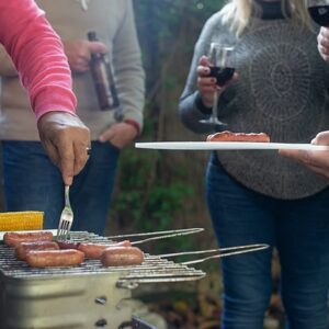 people using a barbeque grill